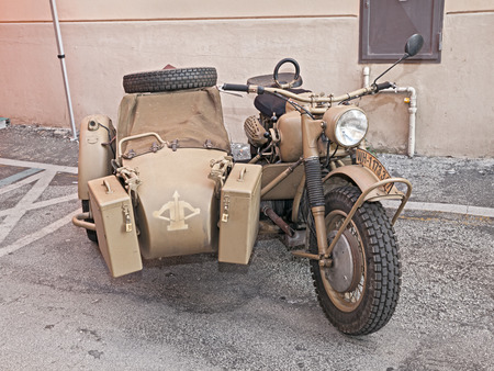 sidecar: old BMW R75 750 cc, World War II era motorcycle with sidecar made in Germany, at the military vehicle rally during the festival Fiera di San Rocco on November 2, 2014 in Faenza, Italy Editorial