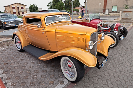 custom car: classic american hot rod Ford 1932 three window coupe in vintage and custom car rally Kustom Revolution on June 15, 2015 in Forlimpopoli, FC, Italy