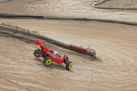 off road: radio controlled buggy car model, internal combustion engine, in regional championship scale 18 off road in dirt track Il Pozzo on April 26, 2015 in Riolo Terme, RA, Italy