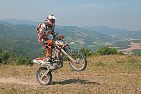 motosport: biker riding enduro motorcycles KTM 350 EXC in the green hills during the Italian championship Motorally Terre di Romagna, on July 5, 2015 in Predappio, FC, Italy