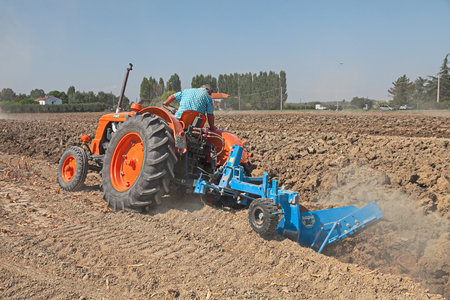 santagata: farmer plowing the field with an old tractor Fiat 80 R 1960 circa and the plow during the country fair Rombi agricoli on August 30, 2015 in SantAgata sul Santerno, Ravenna, Italy Editorial