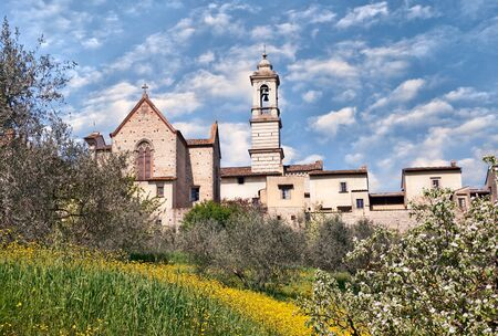 meadowland: view at spring of the Florence Charterhouse Certosa di Firenze, medieval monastery founded in 1341, in Tuscany, Italy Editorial