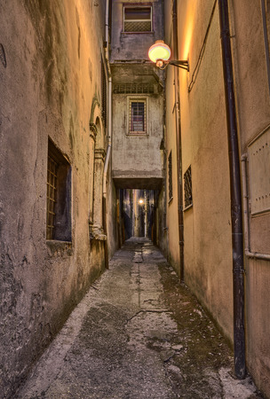 walkway: picturesque old narrow alley at night in the medieval town Guardiagrele, Abruzzo, Italy Editorial