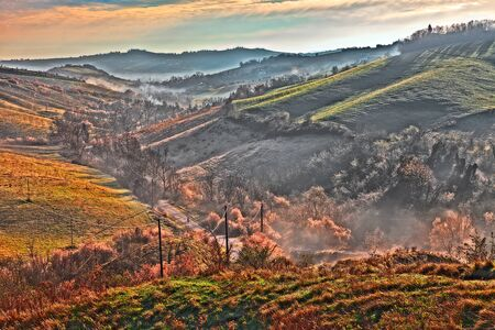 emilia romagna: early morning on the hills of Forli, Emilia Romagna, Italy - italian landscape at dawn with fog in the valley Stock Photo