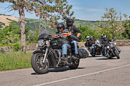 harley davidson motorcycle: bikers riding American bike Harley Davidson on the Italian hills during the motorcycle rally Mototagliatella on May 10, 2015 in Predappio, Italy