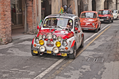 driver on a vintage super equipped car Fiat 500 F 1965 in classic cars rally during the feast Sagra dei sapori dautunno on November 9, 2014 in Bagnacavallo, RA, Italy Editorial