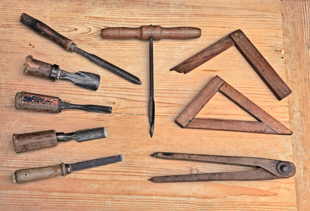 carpenter's bench: vintage woodworking hand tools of an ancient carpentry - old carpenters equipment