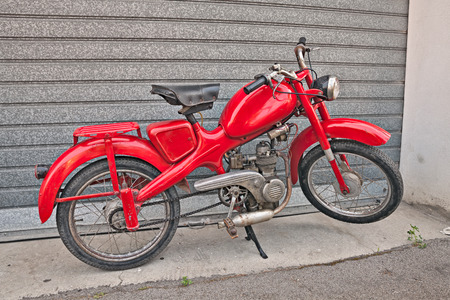economic revival: vintage Italian moped Motom 48, low fuel consumption four-stroke engine, in motorcycle rally Motosalsicciata 2016 on April 10, 2016 in Voltana di Lugo (RA) Italy Editorial