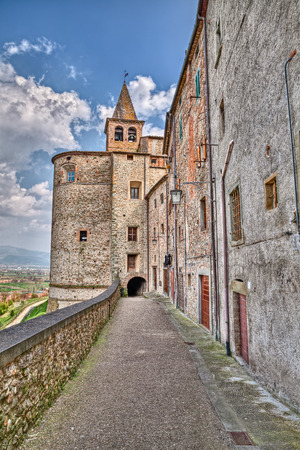 augustine: picturesque old alley with underpass under the Saint Augustine church in the medieval village Anghiari, Arezzo, Tuscany, Italy
