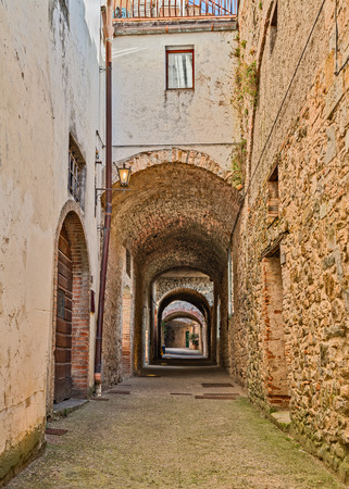 volte: the picturesque covered street Via delle Volte, a medieval narrow alley in Castellina in Chianti, Siena, Tuscany, Italy