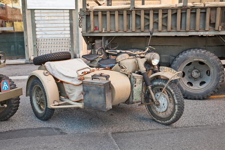 Reich: old motorcycle with sidecar made in Germany BMW R75 750 cc World War II era in military vehicle rally during the festival Fiera di San Rocco on November 2, 2014 in Faenza, Italy Editorial