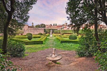italy landscape: the public garden Horti Leonini, an ancient giardino all italiana typical classic Italian garden based on symmetry and perfect geometry, in San Quirico dOrcia, Siena, Tuscany, Italy