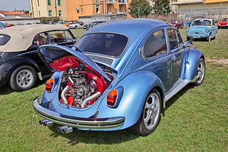 chromium plated: vintage Volkswagen Type 1 (Beetle) with tuned chromed engine in classic car rally Raduno auto e moto depoca on April 11, 2015 in Traversara, RA, Italy Editorial