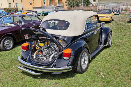 tuned: vintage Volkswagen Type 1 (Beetle) with tuned chromed engine in classic car rally Raduno auto e moto depoca on April 11, 2015 in Traversara, RA, Italy Editorial