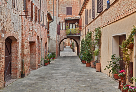 italy street: picturesque narrow street in the historic center of the village Buonconvento in Siena, Tuscany, Italy