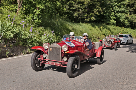 italian car: driver and co-driver on an old Italian car Lancia Lambda tipo 221 Spider Casaro (1928) travel in Tuscany during the historic race Mille Miglia, on May 21, 2016 in Passo della Futa (FI) Italy