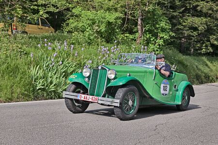 augusta: driver and co-driver on a vintage Lancia Augusta Cabriolet (1934) in classic car race Mille Miglia, on May 21, 2016 in Passo della Futa (FI) Italy Editorial