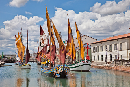 sea fishing: the port canal of Cesenatico, seaside town in Emilia Romagna, Italy, where ancient fishing sailing boats of the Adriatic sea are displayed in the canal Stock Photo