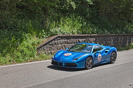 coachwork: driver and co-driver on a sports car Ferrari 488 Spider (2016) in rally Ferrari tribute to Mille Miglia on May 21, 2016 in Passo della Futa (FI) Italy