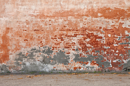 urban decay: old wall with peeling paint and scratched stained plaster - grunge background of urban decay Stock Photo