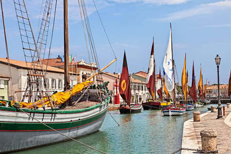 sailing boats: Cesenatico, Emilia Romagna, Italy: the port canal with historic fishing sailing boats of the Adriatic sea