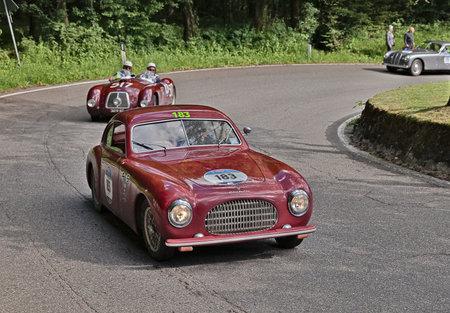 sportscar: PASSO DELLA FUTA (FI), ITALY - MAY 21: driver and co-driver on a vintage sportscar Cisitalia 202 SC Berlinetta Pininfarina (1949) in classic car race Mille Miglia, on May 21, 2016 in Passo della Futa (FI) Italy
