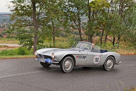roadster: driver and co-driver on a German vintage car BMW 507 roadster (1956) in classic car rally Gran Premio Nuvolari on September 18, 2016 in Meldola, FC, Italy