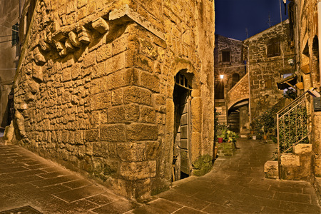 italian village: Pitigliano, Grosseto, Tuscany, Italy: picturesque old alley at night in the medieval town founded in Etruscan time