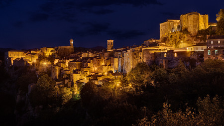 on the hill: Sorano, Grosseto, Tuscany, Italy: night landscape of the picturesque medieval village on the hill