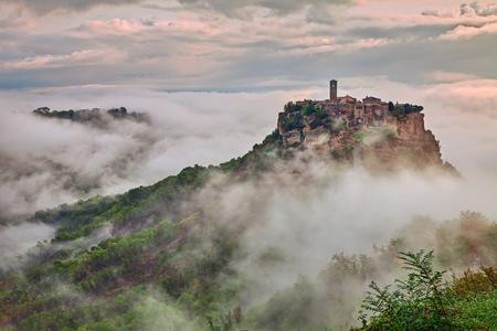 impressive: Civita di Bagnoregio, Viterbo, Lazio, Italy: picturesque landscape at dawn of the ancient village shrouded in fog on the steep tuff hill