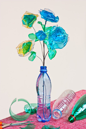 creative recycling: handmade flowers made from scraps of plastic bottles Stock Photo - 68197691