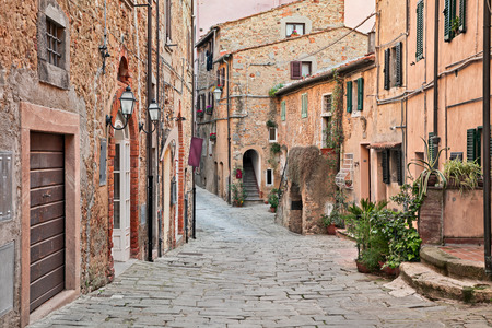 he old: Castagneto Carducci, Leghorn, Tuscany, Italy: ancient street in the old town of Castagneto Carducci, the village where he lived the poet Giosue Carducci