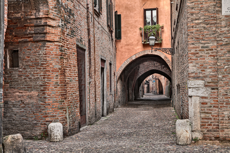 volte: Ferrara, Emilia Romagna, Italy: the picturesque arched alley Via delle Volte, ancient medieval street