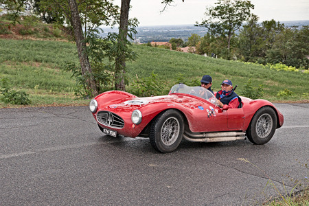 MELDOLA, FC, ITALY - SEPTEMBER 18: driver and co-driver on a vintage Italian car Maserati A6GCS (1954) in classic car rally Gran Premio Nuvolari on September 18, 2016 in Meldola, FC, Italy