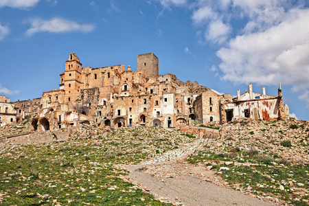 lucania: Craco, Matera, Basilicata, Italy: view of the ghost town that was abandoned  due to natural disasters and now is a tourist attraction and a filming location Stock Photo