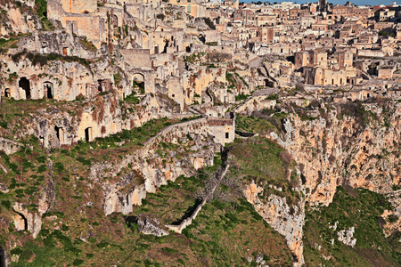 rupestrian: Matera, Basilicata, Italy: landscape at sunrise of the old town (sassi di Matera), with the houses carved into the tufa rock over the deep ravine
