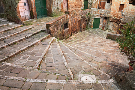 founded: Pitigliano, Grosseto, Tuscany, Italy: picturesque old staircase in the medieval town founded in Etruscan time