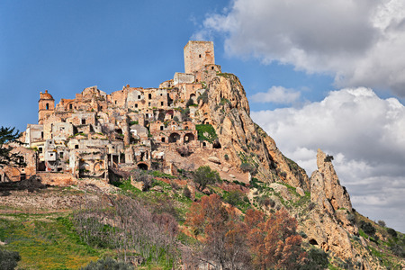uninhabited: Craco, Matera, Basilicata, Italy: view of the ghost town that was abandoned  due to natural disasters and now is a tourist attraction and a filming location Stock Photo