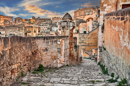 Matera, Basilicata, Italy: picturesque view at sunrise of an ancient alley in the old town sassi di Matera, European Capital of Culture 2019