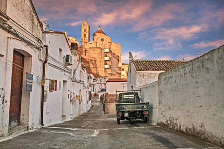 alley in the old town with the typical houses and the ancient mother church in the background. Photo taken on March 11, 2017 in Pisticci, Matera, Basilicata, Italy