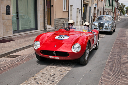 driver and co-driver on a vintage racing car Maserati 150 S (1955) during the historical classic car race Mille Miglia, on May 19, 2017 in Gatteo, FC, Italy Editorial