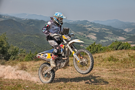 biker riding enduro motorcycles Husqvarna 450 in the green mountains during the Italian championship Motorally Terre di Romagna, on July 5, 2015 in Predappio, FC, Italy