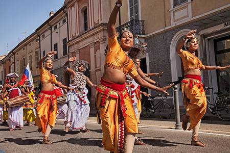 RUSSI, RA, ITALY - AUGUST 3: folk dancers from Sri Lanka performs traditional dance in the town street during the International Folklore Festival, on August 3, 2017 in Russi, Ravenna, Italy