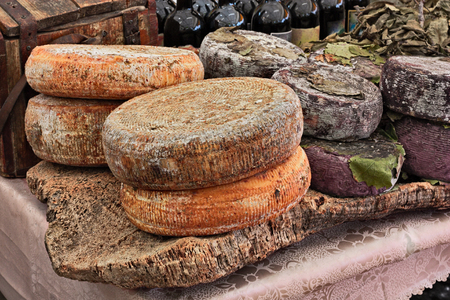 sheep milk cheese from Sardinia, Italy, on a piece of cork - traditional artisan food product in Italian market Reklamní fotografie