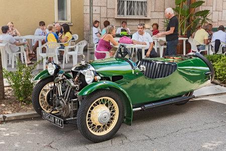 British three wheeler car Morgan MX4 (1934)in classic car and motorcycle rally Motoraduno dEpoca, on August 25, 2013 in San Patrizio, RA, Italy