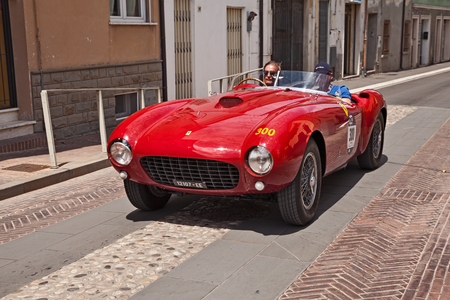 driver and co-driver on a racing car Ferrari 375 MM Spider Pinin Farina (1953) in historical classic car race Mille Miglia, on May 19, 2017 in Gatteo, FC, Italy Editorial
