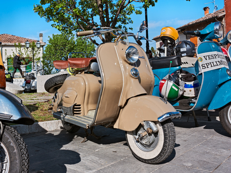 vintage italian scooters Lambretta and Vespa in motorcycle rally of Vespa Club Santarcangelo di Romagna - Poggio Berni, Rimini, Italy - April 9, 2012 Editorial