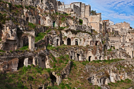 Matera, Basilicata, Italy: landscape at sunrise of the old town called Sassi di Matera with the houses carved into the tufa rock over the deep ravine Banco de Imagens