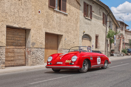 vintage sports car Porsche 356 1500 Speedster (1954) travels in tuscany during the historical rally Mille Miglia, on May 17, 2014 in Colle di Val d'Elsa, Tuscany, Italy Editoriali