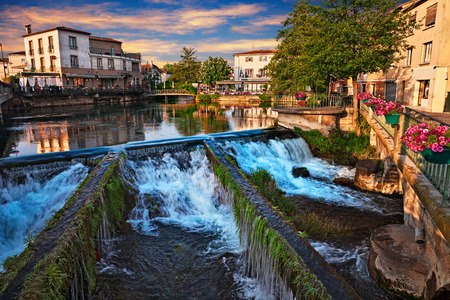 L'Isle-sur-la-Sorgue, Vaucluse,Avignon, France: picturesque landscape at dawn of the town surrounded of the water canals